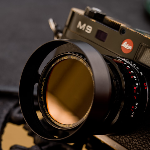 The Leica 50mm APO-Summicron-M APSH f/2.0 LSAH Limited Edition Black Lacquor Paint with the E39 ventilated hood that has a 46mm filter thread in front.