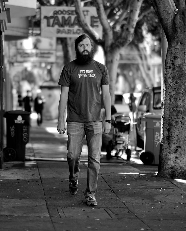 """Fix More, Whine Less"" does this t-shirt say on 24th Street in San Francisco. Leica M9 with Leica 50mm Noctilux-M ASPH f/0.95 and B&W 8X ND-filter. © 2011-2016 Thorsten Overgaard."
