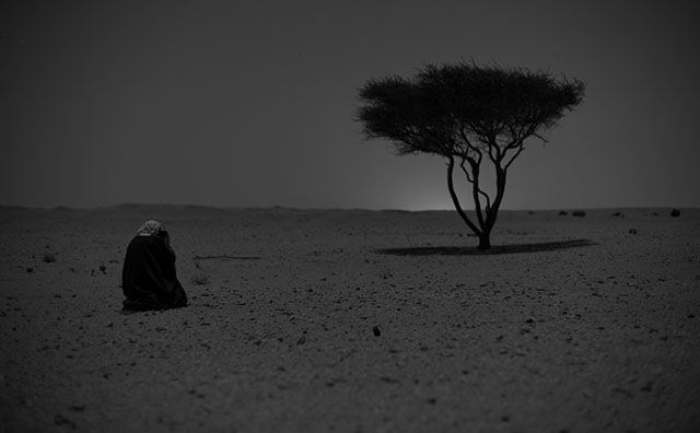 Khalid Al-Thani photographing a landscape with tripod by moonlight