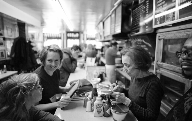 Saturday morning inside Charlie's Sandwich Shoppe. This place was just around the corner of where I stayed in Boston and had become part of my morning ritual. The chef there has three old Leica M3, M2, IIIf cameras and 15 old school lenses that he will send me more info on. I think I can get him upgraded to Leica M9, at least.  The place features great food, resulting in a waiting line outside on Saturdays. Obama was here, and so was Al Gore and Sammy Davis Jr. Charlie's is also known for serving Afro-American musicians when nobody else would, back when. Leica M 240 with Leica 21mm Summilux-M ASPH f/1.4. Thorsten Overgaard © 2014