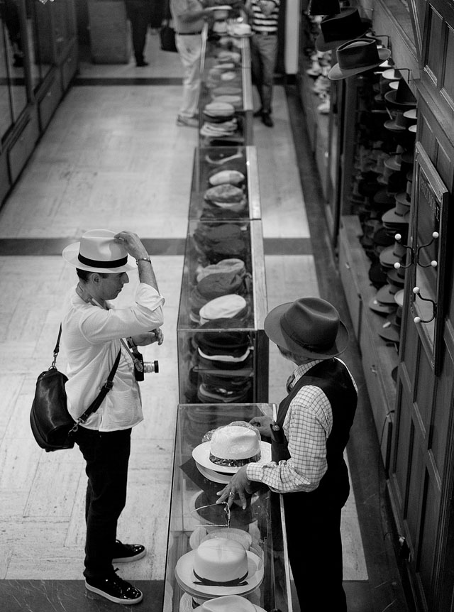 The workshop trying on a hat in JJ Hat Center on 5th Avenue. Photo by Thorsten Overgaard.