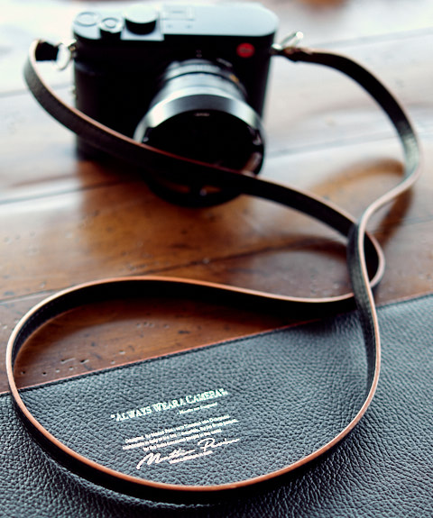 The Black Calfskin Orange Edge Camera Strap on the Leica Q2.