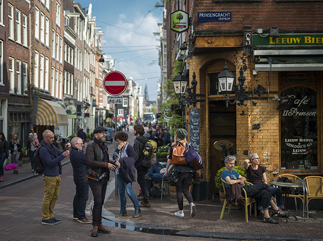 Thorsten von Overgaard lost in the street amidst tourists and evening sun in Amsterdam. Photo by Mathijs Mennen.