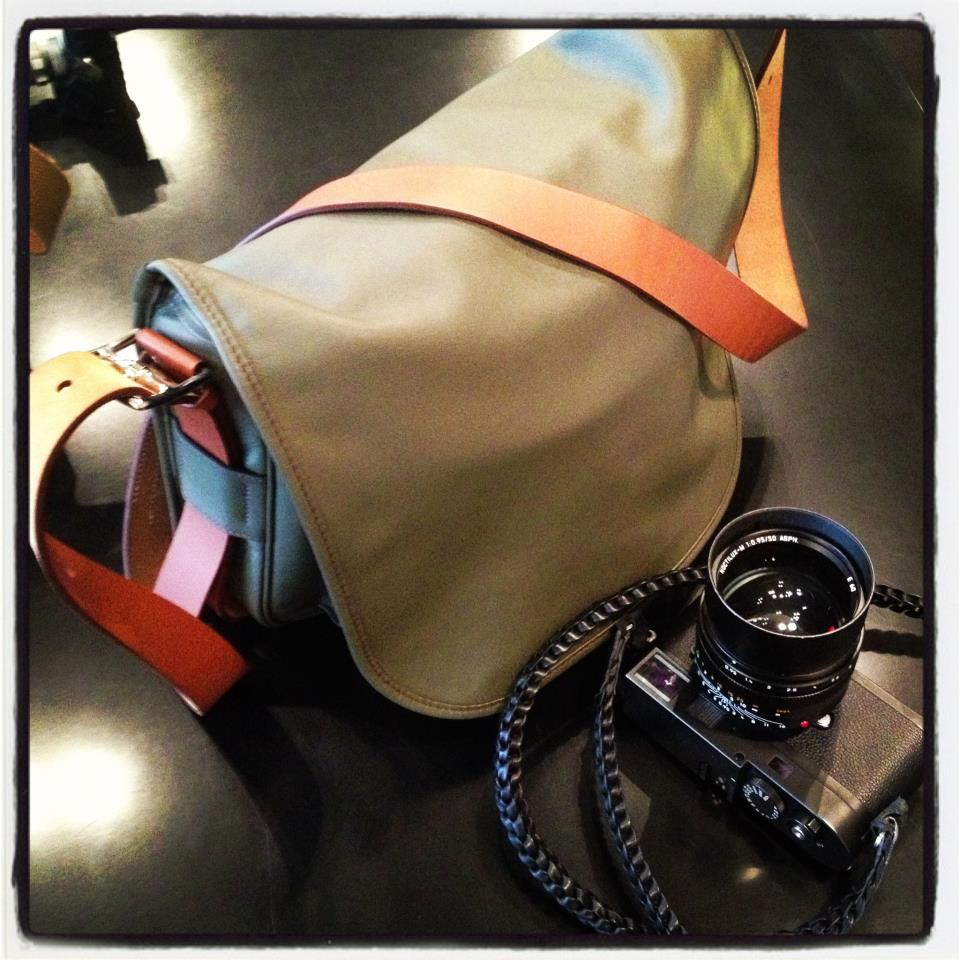 "Hermés Barda camera bag and Annie Barton camera strap. The Hermés ""Barda"" bag comes in two sizes, 35 x 27 x 7 cm and 43 cm and in etain/pewter and ebene/ebony colors and black sikkim calfskin leather. The price is HK$49700 and HK$58600 respectively."