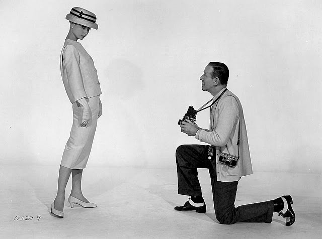 Audrey Hepburn in the studio with Fred Astaire who has his Leica and Rollieflex.