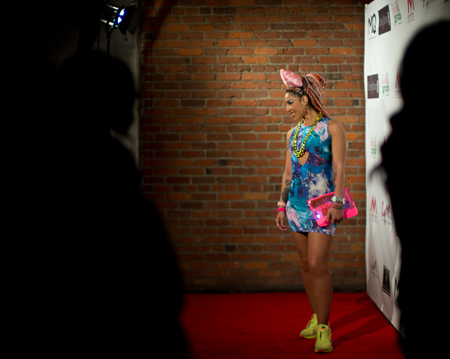 Joy Villa at Urban Music Executives Toast red carpet in ears from Disneyland and Nike shoes.