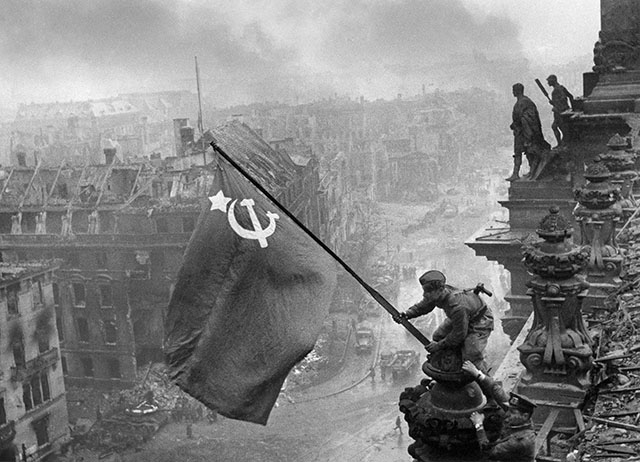 Jewgeni Chaldej's was a Soviet Red Army naval officer and photographer (1917-1997), and a Leica photographer. His famous photo from May 2, 1945 of a Soviet soldier Raising a flag over the Reichstag, in Berlin after Nazi Germany was defeated. Jewgeni Chaldej became a photographer at age 19. His father and three of his four sisters were murdered by the Nazis during the war.