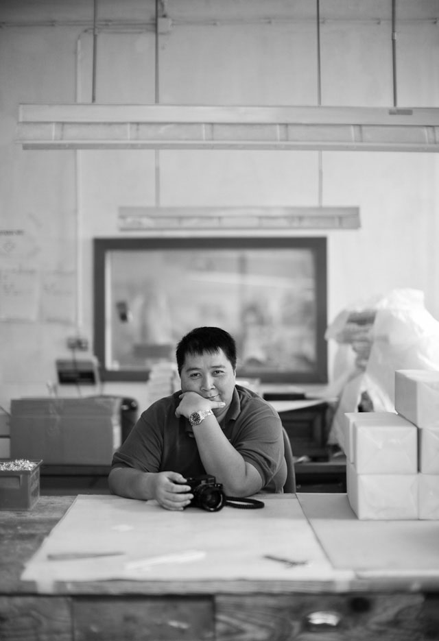 Sony Hassan from Jakarta in Vienna, patiently waiting to shoot the model inside a boxmaking factory.