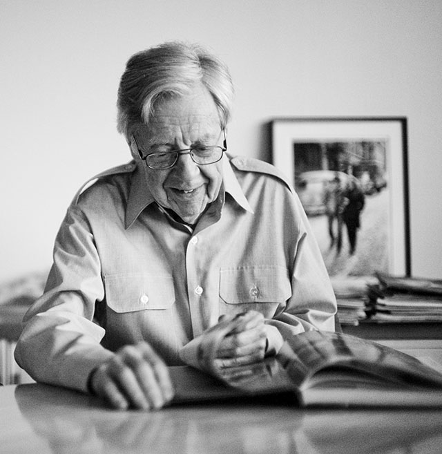 Don Hunstein in his apartment by Central Park in New York, with his book Keeping Time on the table and one of the Bob Dylan Freewhelin' images in the background. Leica M 240 with Leica 50mm Noctilux-M ASPH f/0.95.