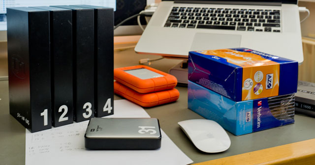 External hard drives is the most low-tech and simple way to back up yor computer and archives.