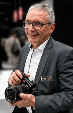Lens designer Peter Karbe at Photokina 2016. Photo by David Farkas.