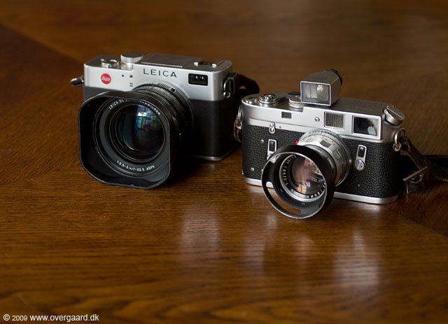 Leica Digilux 2 next to the Leitz M4 in chrome from 1974