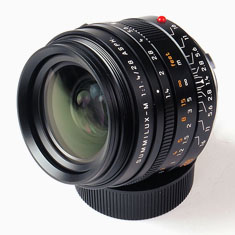 Leica 28mm Summilux-M ASPH f/1.4 (Model 11668). Pice $6,595.00 from Amazon or BHPhoto.