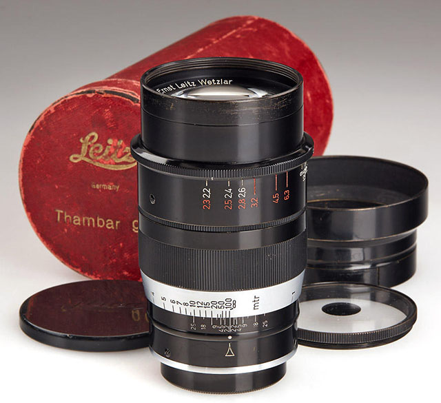 "When you have explored the Leica M lenses, you may start exploring the less expensive and/or the more rare and expensive Leitz Screw Mount lenses. One of the exotic ones is this Leitz 90mm Thambar f/2.2 that was deliberately made to create ""blurry portraits"". The complete set (as above) consist of the original red box, lens cap, lens shade and the special soft focus filter with a black dot in the middle. They exist with the focusing scale in either Meter or Feet. Only 3,500 or less were made from 1934-1940, from serial number 226001 to 540500 and the price usually starts from $3,000. I've been there, done that, as you can read more about in my article here: ""Leitz 90mm Thambar f/2.2""."