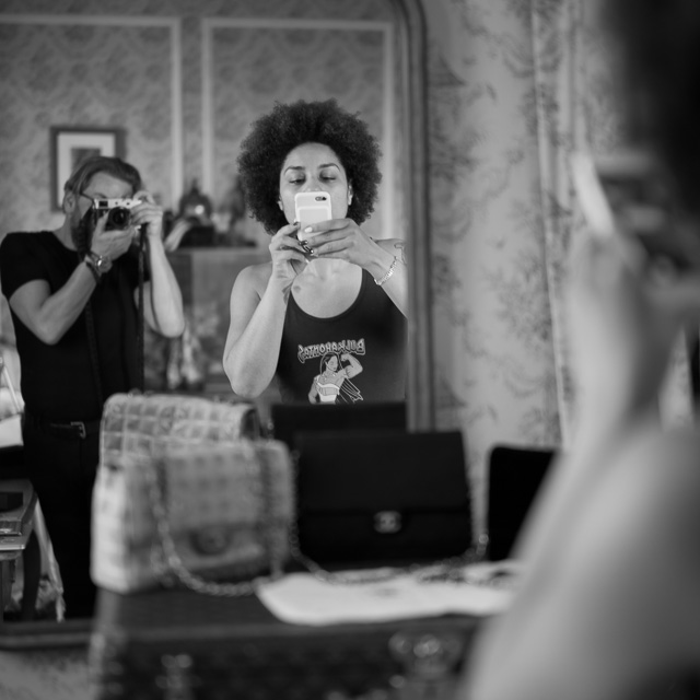 Family Instagram'ing. Joy Villa working on her Chanel bags with me in the mirror. Leica M10 with Leica 50mm Noctilux-M ASPH f/0.95 FLE. © 2017 Thorsten Overgaard.