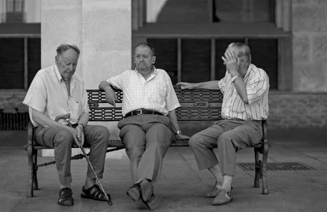 Locals engaged in a talk about what happened in life today, I guess. Leica M10-P with Leica 50mm Noctilux-M ASPH f/0.95. © Thorsten Overgaard.