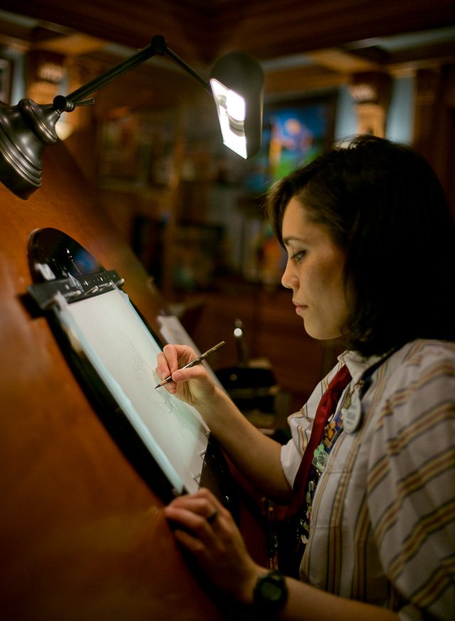 Megan Matsumoto working by the drawing tabe in Walt Disney's original office in Disneyworld