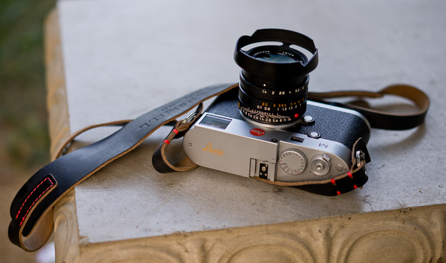 The HAWKESMILL brown leather camera strap is made in England. It's a new brand started in 2016. It has a large o-ring and a protector for the camera body so it doesn't get scratched. They are also making some nice camera bags. Leica M 240 with orange engraving on top (made by Leica Camera in Wetzlar) and 35mm FLE with my own designed ventilated lens shade