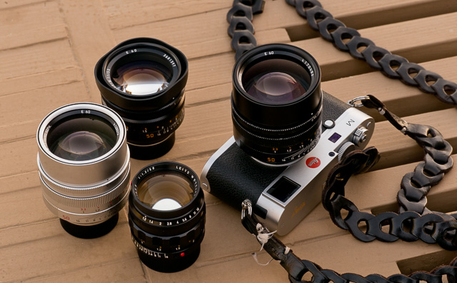 The Noctilux family (from bottom and clockwise): The very first 1966-model, the Leica Noctilux-M f/1.2 ASPH (model 11820, 1966-1975), the current 2008-model in silver, 50mm Noctilux-M ASPH f/0.95 FLE (FLoating Element, model 11667), the 50mm Noctilux-M f/1.0 with built-in hood (model 11822), and on the Leica M240 camera, the current 50mm Noctilux-M ASPH f/0.95 in black (model 11602). Not shown in the picture is the previous models of the 50mm Noctilux f/1.0 (three versions of the model 11821 from 1976-1993 with bayonet or clip-on lens shades; all of which has the same optical design as the one with the built-in plastic hood, but filter sizes from 58mm to 60mm). © 2016-2018 Thorsten von Overgaard.