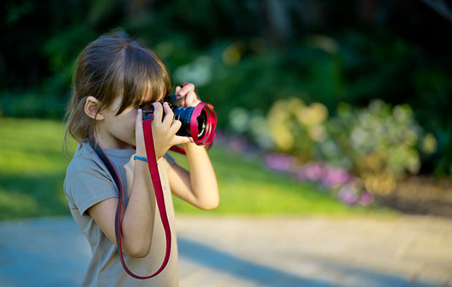 My young Italian friend with the Leica Q. She's 6 years and at that age many semi-pro cameras are acutally too heavy to hold up for kids. But the Leica Q works. Notice the RED Ventilated Shade, she liked that too! © 2017 Thorsten Overgaard.