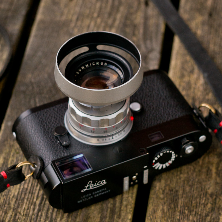 The Leica 50mm Summicron-M f/2.0 Version II Rigid with the silver ventilated lens shade by Thorsten von Overgaard.