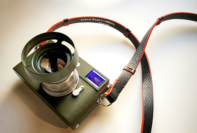 "Leica M10-P Safari in olive green. Here with the ""Concorde"" camera strap in black. Leitz 50mm Summicron-M f/2.0 ""Rigid' lens and E39 ventilated shade in Safari Green (Olive)."