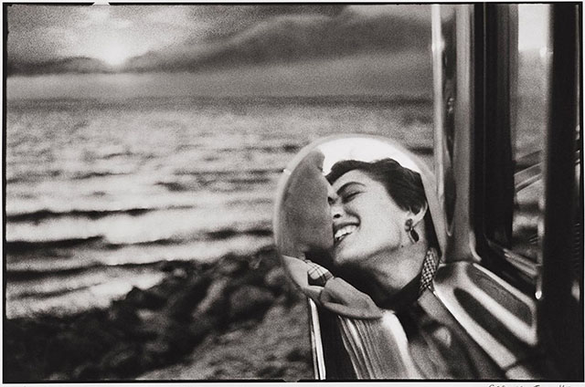 The California Kiss by Elliott Erwitt, taken on a holiday in 1955. It wa lying around unnoticed in the Magnum Photo archives till Elliott found it when he was preparing a 1982-exhibition.