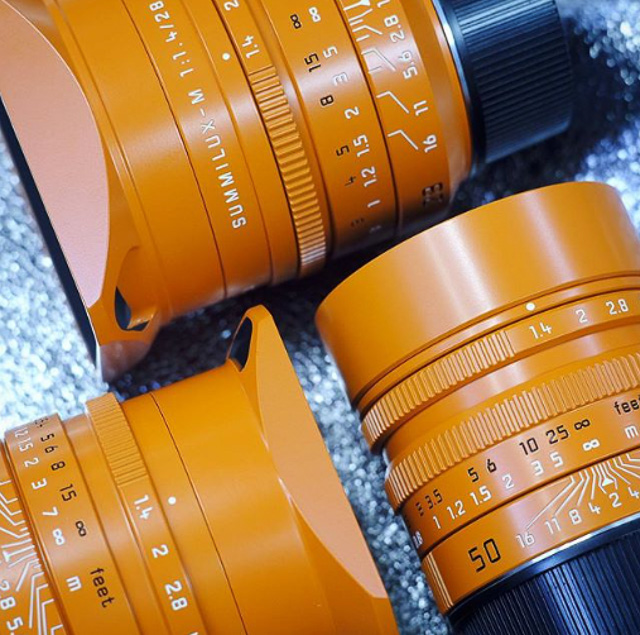 Orange painted 50mm, 35mm and 28mm Summilux lenses from Kantocamera