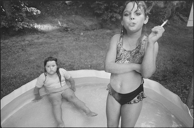 "In 1990, American photographer Mary Ellen Mark (1940-2015) photographed ""The Smoking Girl"" Amanda Marie Ellison, 9 (and Amy Minton Velasquez, 8 sitting) in the ""Sin City"" disctict of Valdese, N.C. for Life magazine to cover a school for ""problem children"" ."