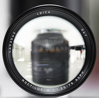 Lens engravings  Almost all Leica lenses have the vital information engraved on the front:  Brand name, focal length, aperture and name of the lens. Usually also the filter size (E67 = 67mm).