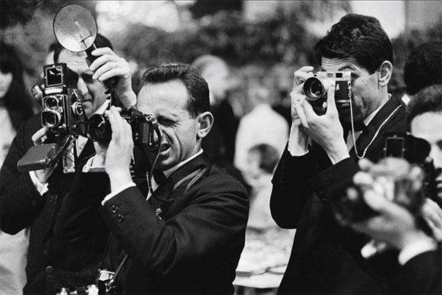 By the 1970's professional photographers used all sorts of camera systems, not mainly Leica cameras anymore. © Paul Schutzer/LIFE.
