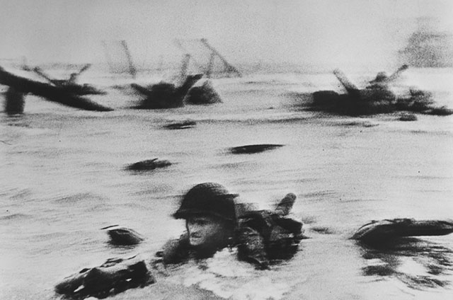 "Robert Capa's ""American troops landing on Omaha Beach, D-Day."" from 1944."
